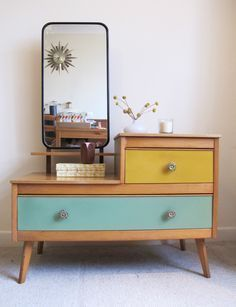 Cool retro dressing table, with painted drawers in teal and mustard. #retrohomedecor