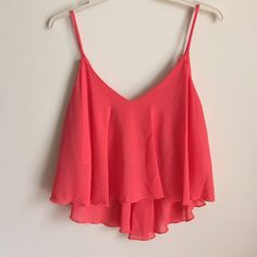 High Low Crop Top High Low Coral Crop Top. NWOT. Available in small and medium. Tops Crop Tops