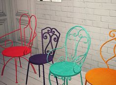 Colored Metal Chairs. I see these with white lights in the backyard.