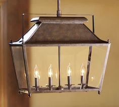 by Pottery Barn  Stanyan Lantern - $399.00 »    The shape of this lantern makes it perfect for hanging over a kitchen island or rectangular dining table.  I like that it's casual enough for informal spaces.  I also think it would be pretty fantastic painted!