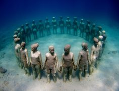 Jason deCaires Taylor, my favorite sculptor. He makes sculptures that get placed on the bottom of the ocean to be covered with coral, which results in coral reefs.