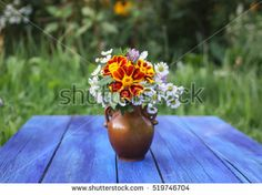 Yellow Marigolds or tagetes erecta flowers. Bouquet on the wooden table.