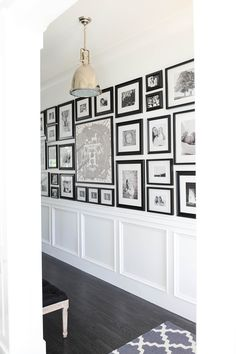 Photo wall for hallway above molding black and white keeping it simple with a variety of photos Monika Hibbs - Tracey Ayton Photography