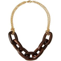 Kenneth Jay Lane link necklace.  Approx.  24L; 1.5L drop.  Polished 22-karat yellow gold-plated hardware.  Seven large, polished oval wood links at center.  Do…