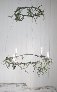 evergreen and candles by Johanna Flyckt Inredningsstylist