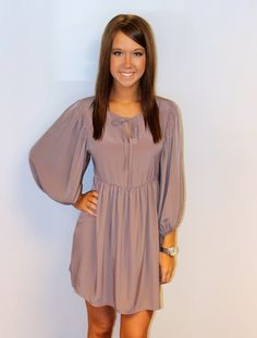 pretty! love the color, the sleeves, and the draping -- Light purple fall dress.  With cowgirl boots! I want!