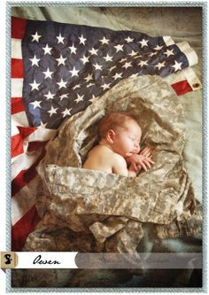 USA flag and baby in Dad's fatigues