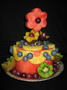 Watermelon cake by KZ. Learn how to make your own watermelon cake at http://www.vegetablefruitcarving.com/watermelon-cakes/