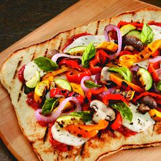 Grilled Vegetable Pizza: Roasted tomato sauce, basil, sauteed zucchini, broccoli, caramelized onions and tomatoes with mozzarella, fontina and pecorino romano cheese.