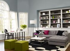 Living room painted in a blue-grey colour combination.  van courtland blue HC-145, simply white 2143-70 & stone brown 2112-30 (Benjamin Moore)