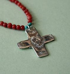 Coral necklace with cross accented with heart by sheny on Etsy,
