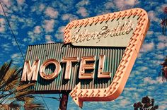 "Picture an old motel sign like this, except it says ""Placent_a Arms.""  Used to say Placentia Arms but the ""i"" burned out."