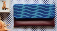 Blue ikat and faux leather foldover clutch