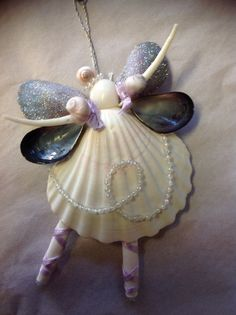 Handmade Nutcracker Sweet Ballerina Seashell Angels are so fun Dancing. Each Angel has a Large White Scalloped Seashell. Arms are Dentalium (a kind of worm She