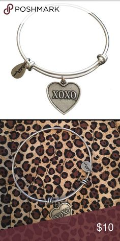 XOXO Bella Ryann ••• Hello  Welcome to my closet!   Expandable silver XOXO bracelet. 1st picture is from the website and second is the actual picture, received as a gift and never worn selling online for 20.   A bundle of 3+ is 15% off!  Make me an offer Thanks for looking!!!  ••• Bella ryann Jewelry Bracelets