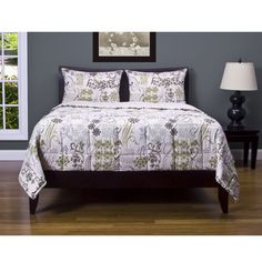 Add a quaint look to your bed with this floral comforter set. Made from silky, soft 100 percent polyester and featuring a green and cream floral motif, this cozy comforter set comes with two matching shams, helping you create the perfectly made bed.