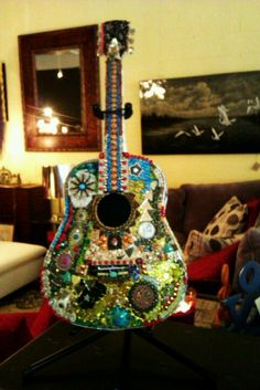 """Funky guitar art at """"There's No Place Like Home"""""""