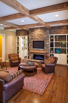 Family room with reclaimed ceiling beams and mantel by Sally Williams, via Behance