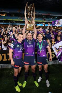 Cooper Cronk, Cameron Smith and Billy Slater of the Storm pose with the Provan-Summons Trophy after winning the 2017 NRL Grand Final match between the Melbourne Storm and the North Queensland Cowboys at ANZ Stadium on October 1, 2017 in Sydney, Australia. http://footyboys.com