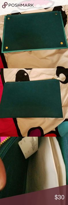 Two Toned Green  Neiman Marcus Clutch NWT This super chic clutch is a dark bluish green with a metallic turqouise green border. Gold button stud details and is a medium size clutch. Brand new with tags attached! Neiman Marcus Bags Clutches & Wristlets