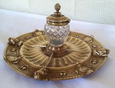 ELKINGTON ART GOLD GILDED BRONZE INKWELL. Truly a rare find, this inkwell was made by Elkington & Co. circa 1860 - 1870. The pen tray flows like a lily pad toward the center cut glass inkwell with hinged ornate lid. | eBay!