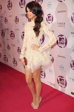 Stunning little lace white dress on Selena Gomez