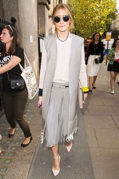 How To Wear All Gray Like An It Girl #refinery29  http://www.refinery29.com/2014/09/74489/olivia-palermo-all-gray-outfit#slide1  Head-to-toe gray (with a tad of colorblocking in the sweater) makes for an all-star office outfit. Bonus: You can shop her Nom De Mode waistcoat, Dior sunglasses and Capwell & Co. necklace in the slides ahead.
