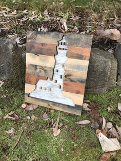 This rustic wood lighthouse silhouette wall art is made out of pine uniquely stained to look like rustic reclaimed wood. The background is painted white to resemble a real lighthouse and is distressed to continue the rustic style. This piece measures 21x18 and is preinstalled with hanging on the wall. This piece is available to be made in different sizes and with a different assortment of colors. Just message me for details. **NOTE - This piece is made to order. The picture displayed is…