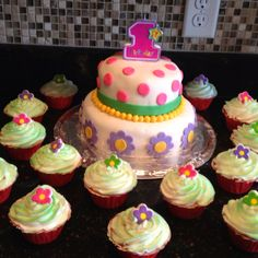 Fondant cake with cupcakes.