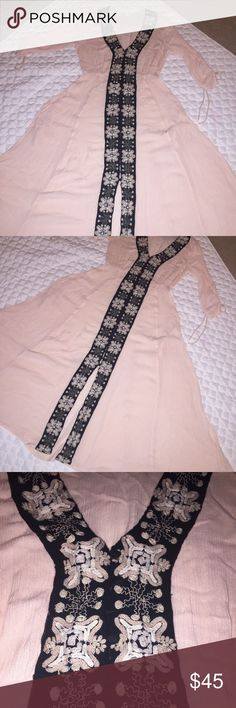 Free People pink/black button up dress Free People pink/black button up dress. Covered black buttons all the way down front. One button missing. Empire waist . Embroidery all the way down the front of dress. Beautiful full dress!!! Free People Dresses Maxi
