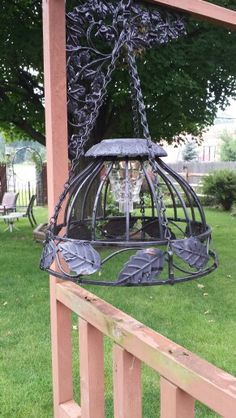 Took a couple of hanging baskets I wasn't using and inverted them and a couple of cheap solar lights, the baskets already had holes in the bottom the exact size of the solar light. In about 5 minutes of work 2 homemade  hanging solar lamps.