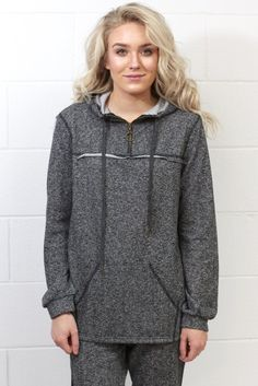 Long sleeve pullover with a zip up front, kangaroo pocket, and hood. Loose fitting. Heather black in color. Plus, it has the cutest matching jogger pants! Lighter weight.