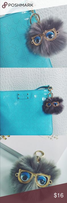 Adorable Gray faux fur Pom Pom Puff Keychain Adorable Gray faux fur Pom Pom Puff Keychain with Blue eye shadow, wandering eyes, and gold glasses. Gold alloy lobster clasp and keychain. Other colors available, please see my other listings or message me for details! Size: 8 cm Accessories Key & Card Holders