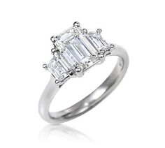 Ring of the Week    Beautiful Trilogy Ring with Emerald Cut Center Diamond:    Carats: 1.023 crt Center Stone            : 0.31 crt Side Diamond Baguettes   Clarity: VS1  Colour: J    Retail Price: R70,000 (have seen this ring in shops for over R100,000)  Princess Diamond Price: R41,900    Unbelievable Price and Amazing Ring!    Email jackie@princessdiamonds.co.za to set up a private viewing x