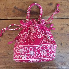 Cute Vera Bradley purse. Used but in excellent like new condition. Hot pink. Draw string bag with handles. Length approx 9 in and width when laid flat 10 in. Vera Bradley Bags