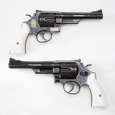 """Smith & Wesson Model 57 - June of 1964 marked the introduction of both the .41 Magnum cartridge and the Smith & Wesson Model 57 revolver. It would be hard to find a nicer engraved example of the """"N"""" frame M57 revolver than this example, fitted with elephant ivory grip panels. The tasteful gold accents don't hurt, either. At the NRA National Firearms Museumin Fairfax, VA:"""