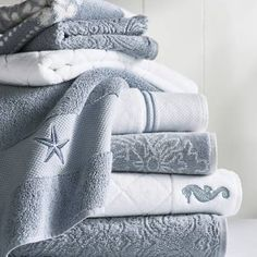Our Resort Bath Towel now comes available with decorative Starfish or Seahorse icons. Softer and longer than towels found at many five-star hotels and spas, our Resort Cotton Towels are lofty, thick, and as luxurious as any in the world. These zero-twist towels are crafted from pure, 100% long-staple Turkish cotton woven to 700 gsm. The end result is luxuriant softness and absorbency that outperforms others. Luxury bath towels are generously oversized in an array of vibr...