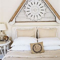 I saw architectural elements like this at Brimfield. Looks great over the bed. Love the linens, esp. the pleated trim on the pillows.