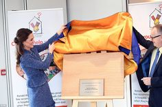Opened! Kate peels back the blue and gold satin to pronounce the new purpose-built accommo...