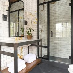 Create a feeling of bathroom space: Floor to ceiling shower tile! (Image Courtesy of Summer Thornton Design)