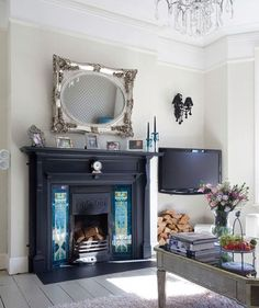 Hanging an ornate mirror above the fireplace is a wise decorative decision and also opens up the room making it feel larger.