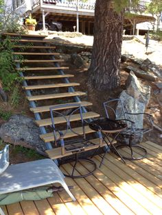 Custom built stairs with wooden treads and welded steel framing. From top of hill down to a Mid deck just above the main dock.