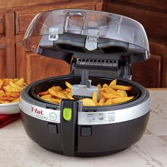 T-Fal Actifry Deep fry with just one tablespoon of oil! So tempted to buy this from work!