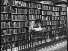 Woman Reading Book Among Shelves on Balcony in American History Room in New York Public Library Photographic Print by Alfred Eisenstaedt at Art.com