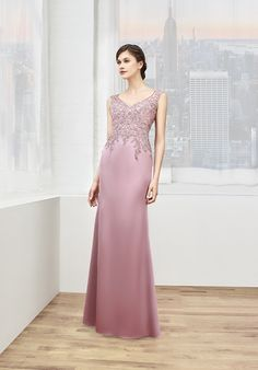 Val Stefani Celebrations style MB7603 highlights a mother of the bride's curvy figure with its sleek satin fit and cocktail train. This elegant floor length evening gown accentuates the natural waist with beaded lace appliques throughout the V-neck bodice. Covered buttons along the illusion lace back complete the sophisticated look.