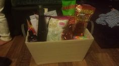 not really a craft but filled a box for a present to create a 'Night In' hamper for a couple with kids. Wine, beer, sweets, popcorn, a voucher for Cook, pyjamas for both of them, and massage oil