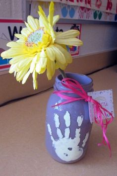 Here's a Mason Jar Mother's Day craft with hand prints Mother's Day Crafts for Kids: Preschool, Elementary and More on Frugal Coupon Living.