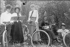 A group of young Schenectadians relax with bicycles, banjo, and songbook, ca. 1909. Photograph from Larry Hart Collection.