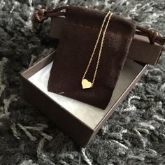 """Happy Valentine's Day! Sweet Tiny Heart Necklace Sweet Gold Toned Tiny Heart Necklace. Adjustable Length, apx. 16.5"""" (See Pic).  Can Be Worn As A Choker or Pair Beautifully With Multiple Layers. Costume Jewelry. BRAND NEW. Arrives Beautifully Packaged Jewelry Necklaces"""
