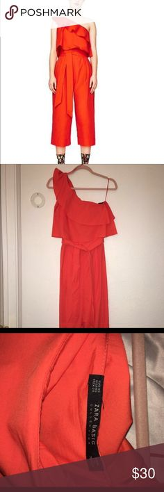 Zara perfect red Christmas romper jumpsuit xs Worn once! Selling as it's not really my style. Looks slightly more orangey-coral versus a true red. Lightweight fabric. Minimal stretch. Size xs. Zips on the side, ties at waist. Zara Pants Jumpsuits & Rompers